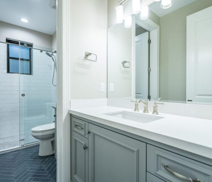 transitional style bathroom in gray with white quartz countertop