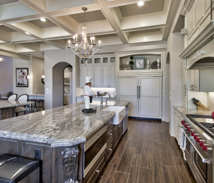 traditional style kitchen in antique wood stain and white with natural stone quartz countertops