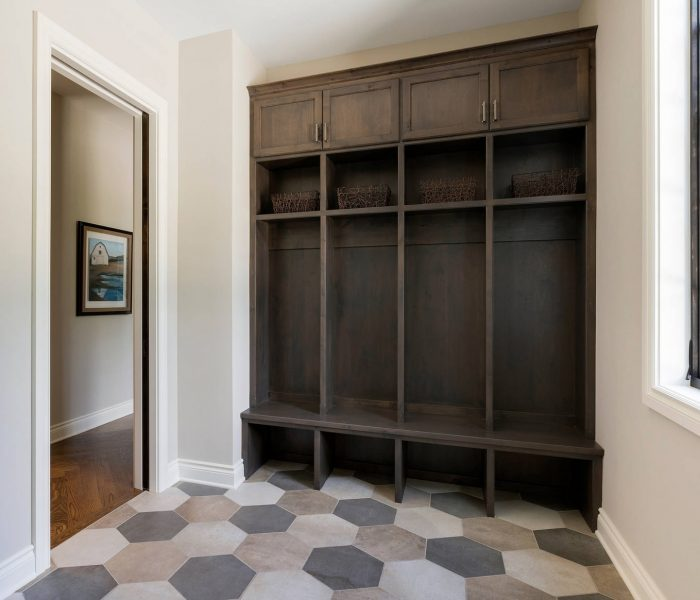 traditional mudroom cabinetry in dark stain