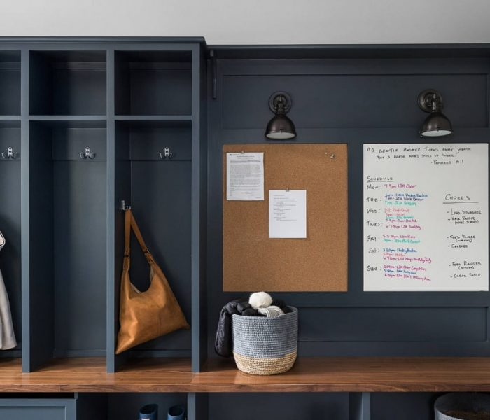 shaker style mudroom cabinetry in blue with natural wood bench