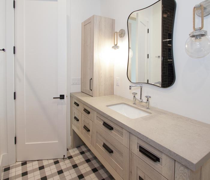 custom-bathroom-light-wood-stain-black-handles