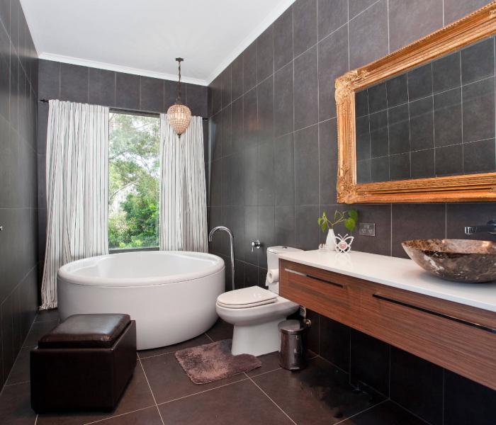 modern style bathroom vanity in dark wood stain with white quartz tabletop