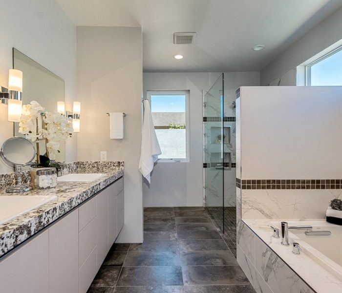 modern style bathroom in gray with quartz countertops