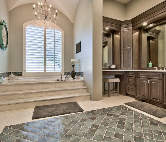 traditional style bathroom vanity and hutch in antique wood stain with white quartz countertop