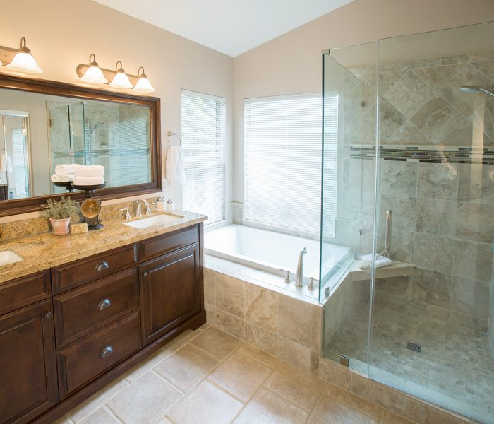 traditional style bathroom in dark wood stain and natural stone quartz