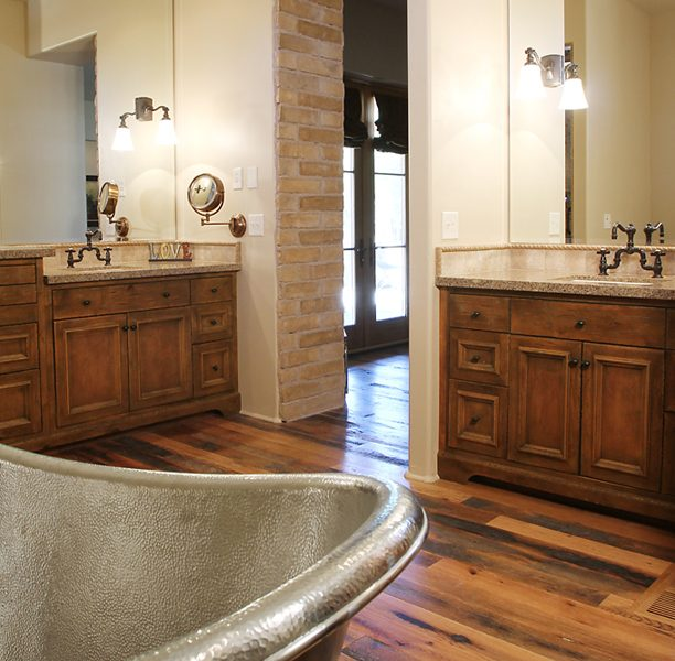 traditional style bathroom vanities in dark wood stain and natural stone quartz