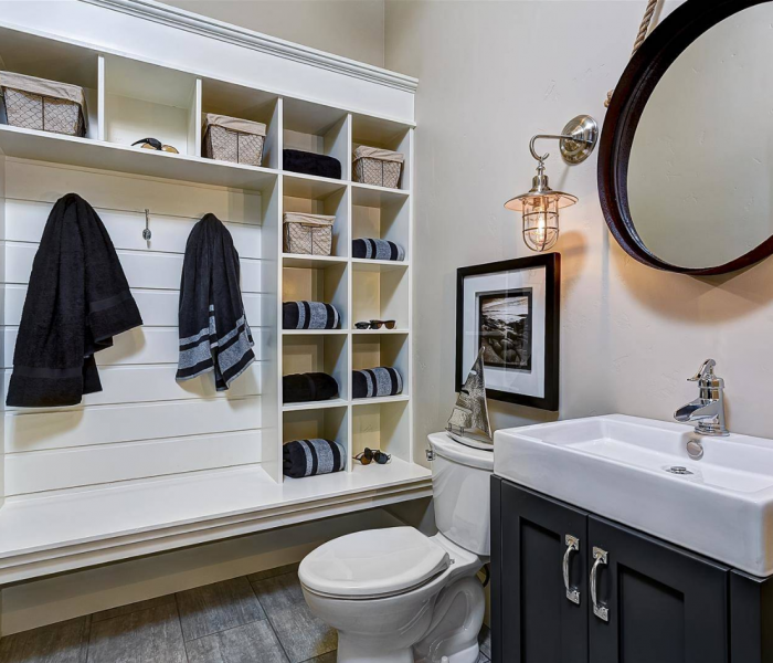 transitional style bathroom with bench in white and dark wood stain