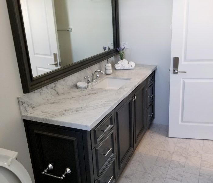transitional style bathroom vanity in black with white quartz countertop
