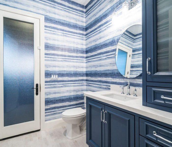 transitional style bathroom vanity in blue with white quartz countertops