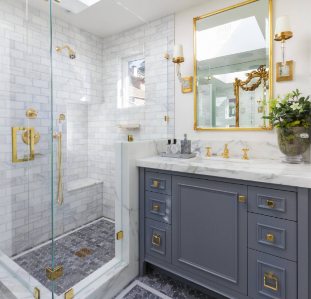 transitional style bathroom vanity in blue and white quartz with gold accents