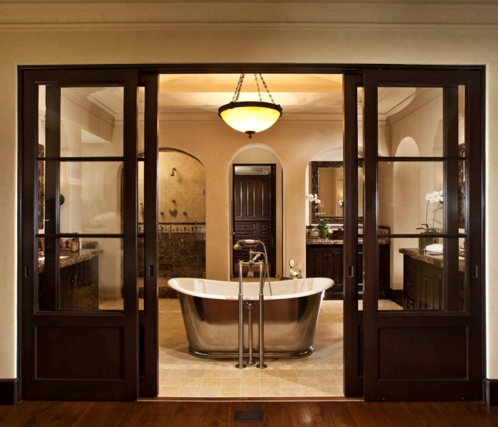 transitional style bathroom in dark wood and stainless steel