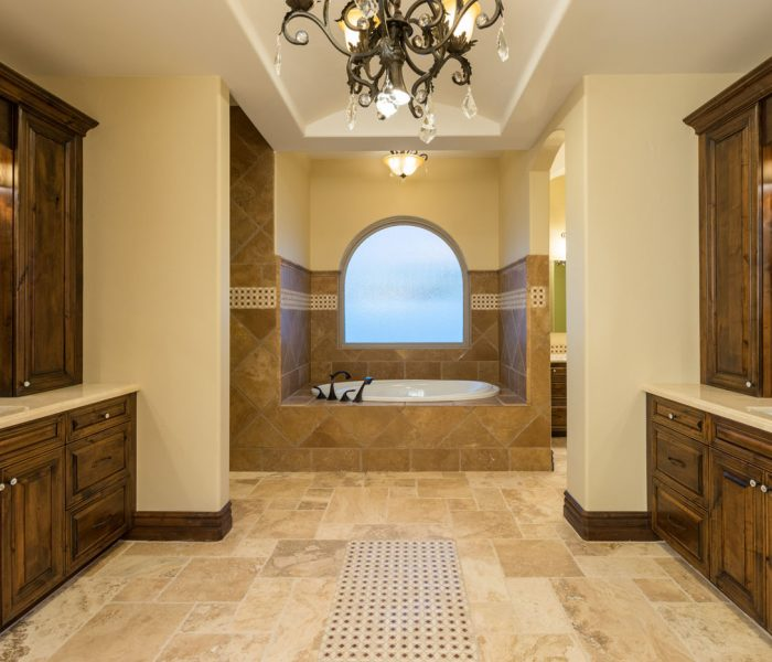 transitional style bathroom in dark wood stain with tiled floor and backsplash