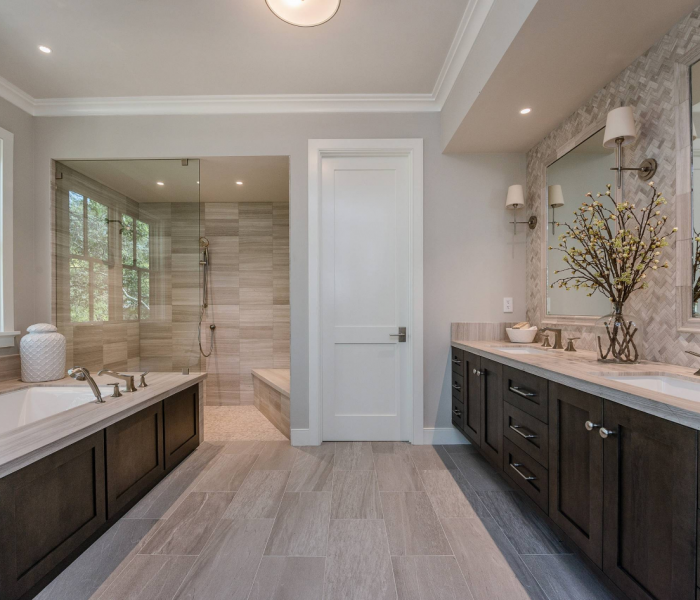 transitional dark wood bathroom cabinetry with white quartz counter top