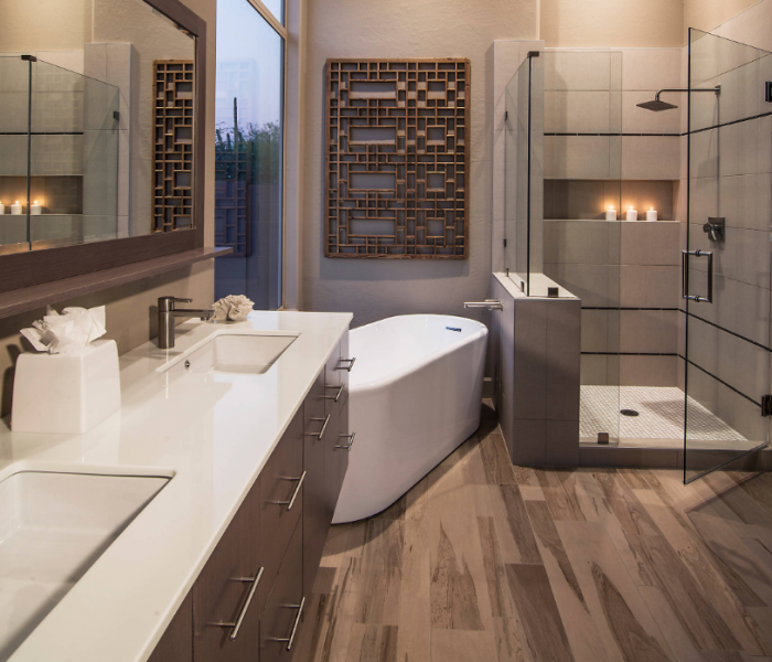 transitional style bathroom vanities in dark wood stain and white quartz countertops