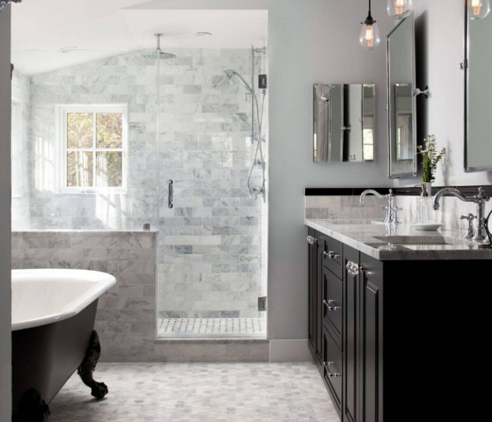 transitional style bathroom in dark wood stain with quartz tile and countertop
