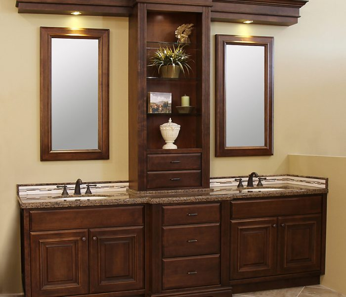 transitional style bathroom dual vanity in dark wood stain with natural stone quartz countertop