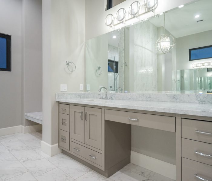 transitional style bathroom vanity in gray with white quartz countertop