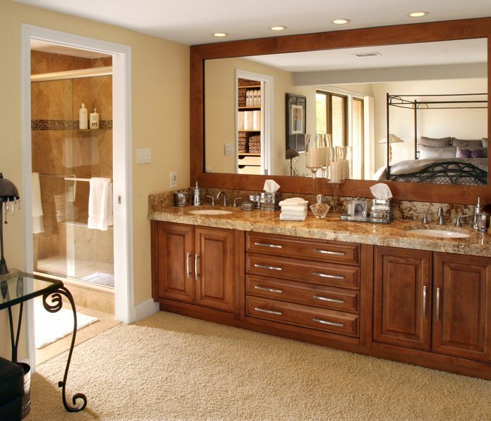 transitional style bathroom vanities in dark wood stain with natural stone quartz