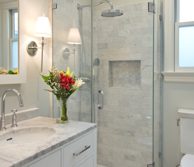 transitional style bathroom vanity in white with gray quartz countertops and shower