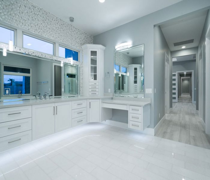 transitional style bathroom in white with gray countertops