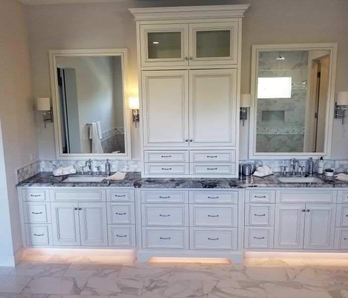 transitional style bathroom vanity in white with marbled quartz countertop