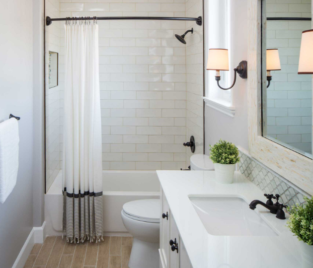 transitional style bathroom vanity in white with white quartz and white tile