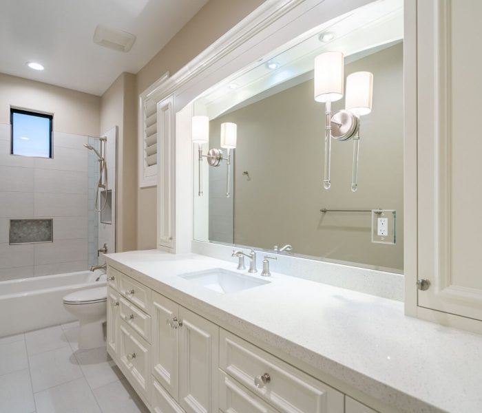 transitional style bathroom vanity in white with white quartz countertop