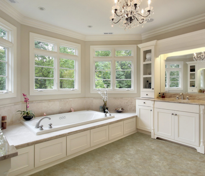transitional style bathroom vanity and bathtub in white and natural stone quartz