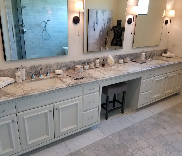 transitional style bathroom in white with natural stone quartz countertop