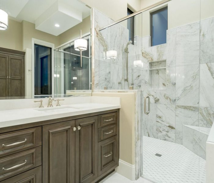 transitional style bathroom vanity in wood stain with white quartz countertop