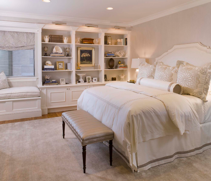 traditional style bedroom and bookcase with bench in white