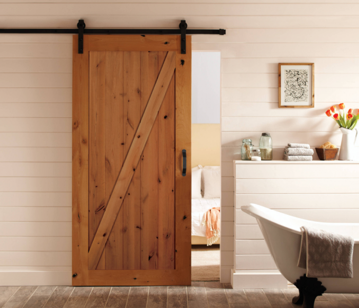 transitional style hallway with shiplap and a barn door