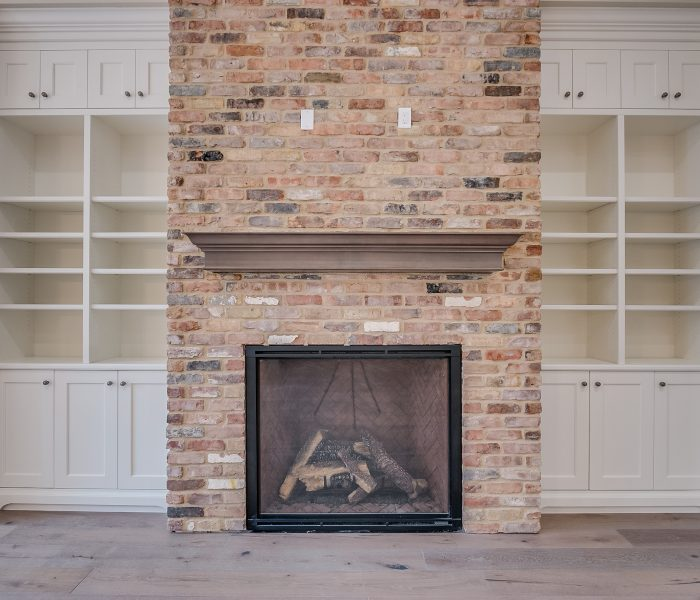 transitional style bookcase fireplace in white and antique brick