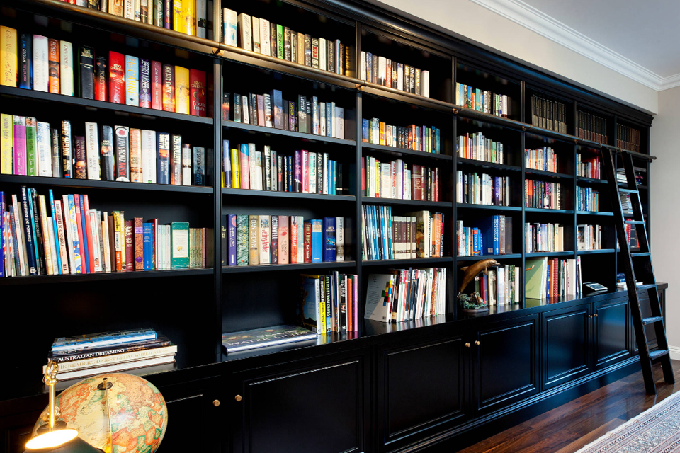 traditional black bookcase with ladder