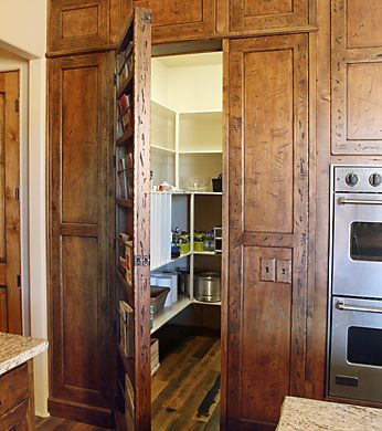 transitional style false bookcase pantry