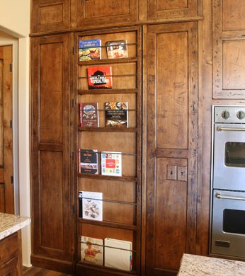 transitional style false bookcase door closed pantry