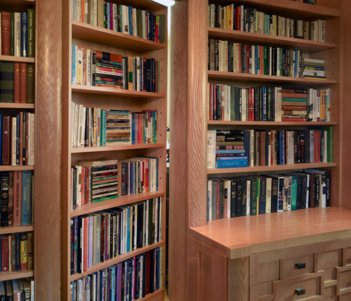 transitional style bookcase door to hidden secret room in natural wood stain