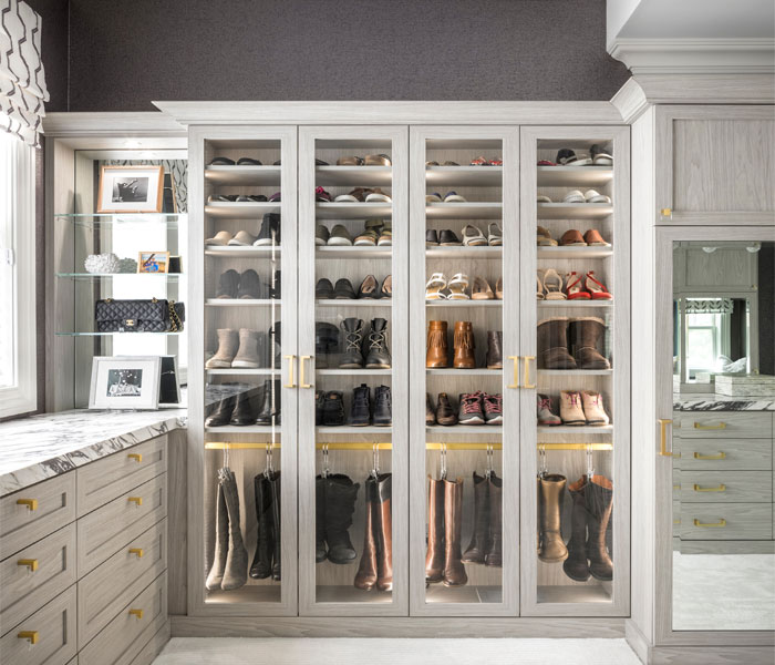 custom-closet-traditional-light-stain-cabinets-glass