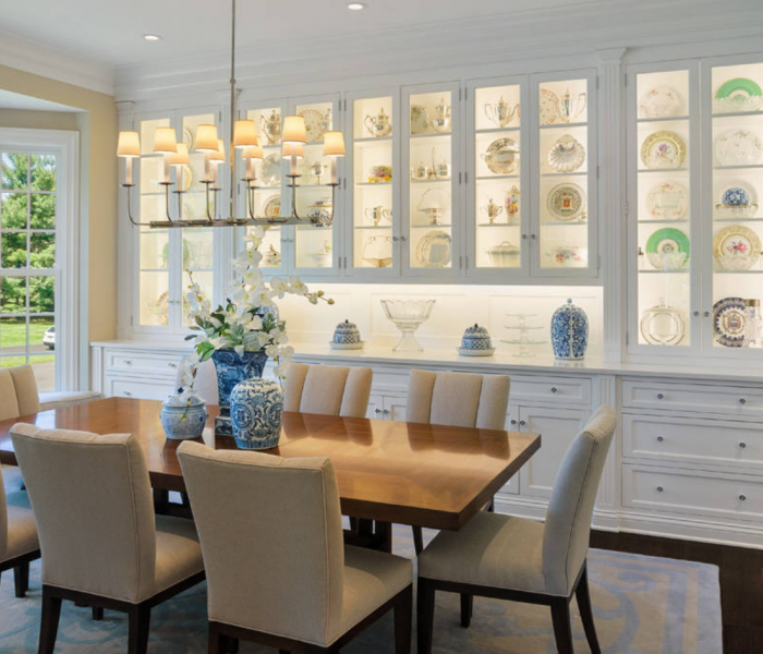 traditional style dining room in white with dark wood accents