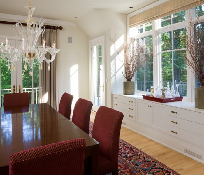 transitional style dining room in white with dark wood table