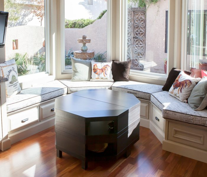 transitional style dining area in white with dark wood stain table