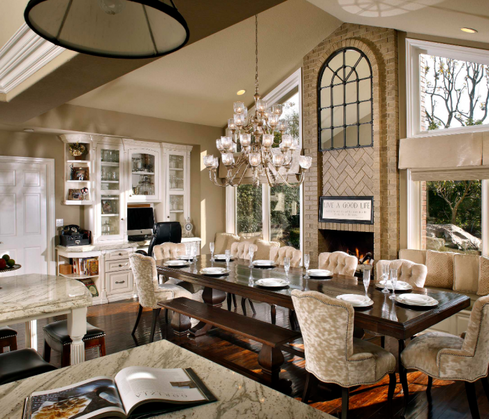 transitional style dining room in white with dark wood banquet table
