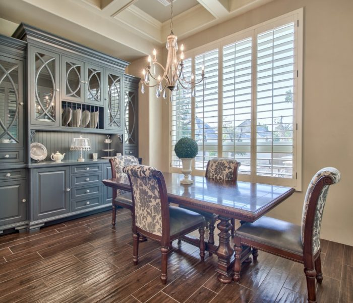 transitional style kitchen dining in blue with dark wood stain table