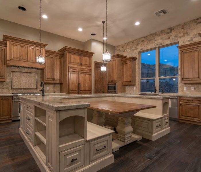 transitional style kitchen and dining room in two tone dark and light antique wood stain