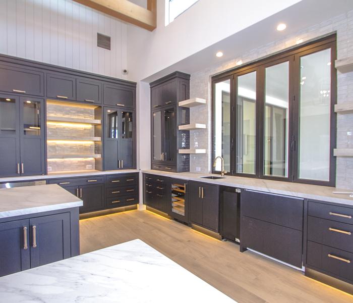 custom-kitchen-islands-gray-shiplap-white-countertops-glass