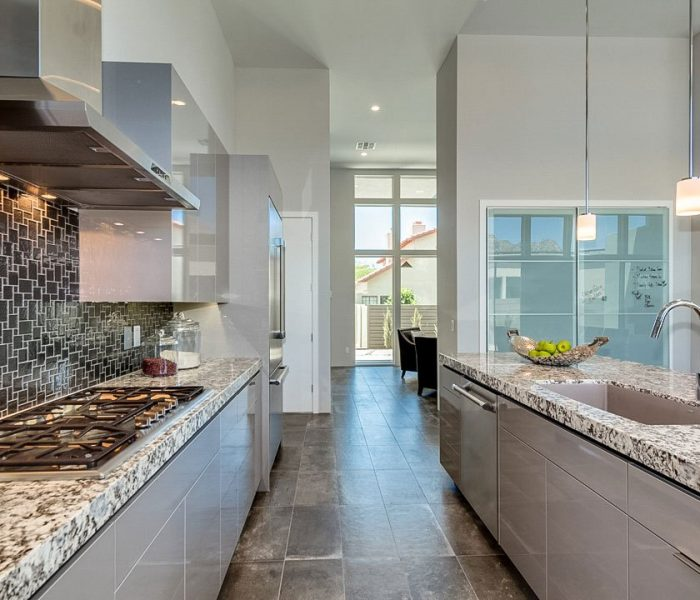 modern style kitchen in grey with marbled quartz countertops