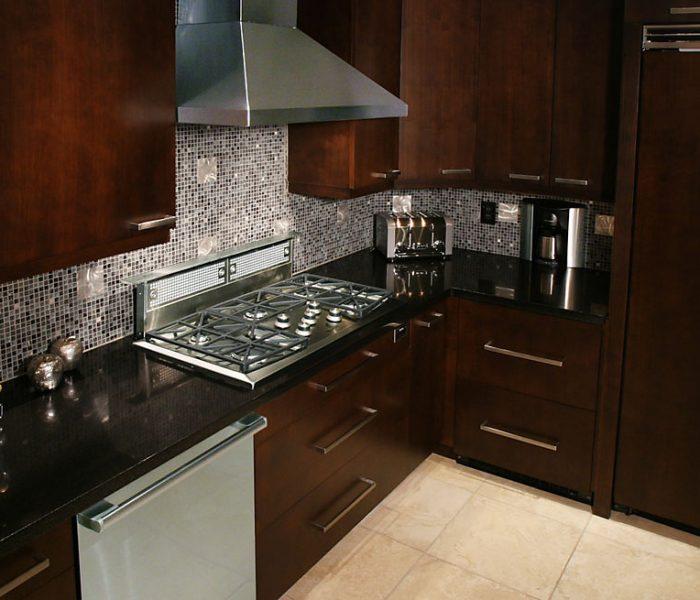 modern style kitchen in dark wood stain with mosaic backsplash tile