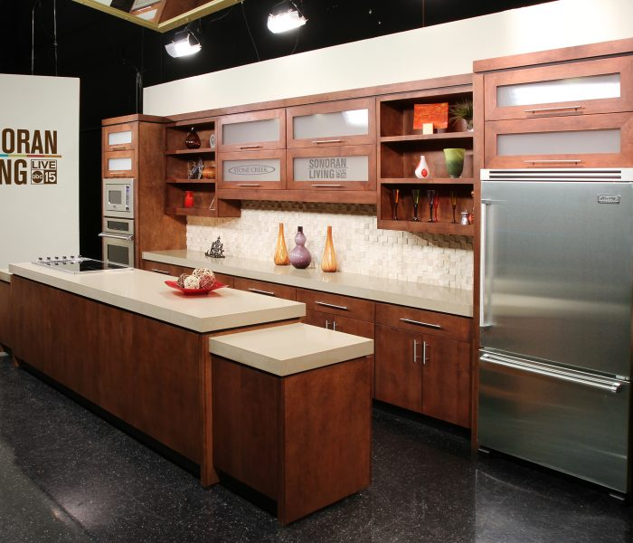 modern style kitchen for ABC news in dark wood stain with white quartz countertops