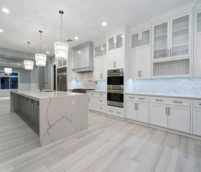 modern style kitchen in white with white quartz countertops