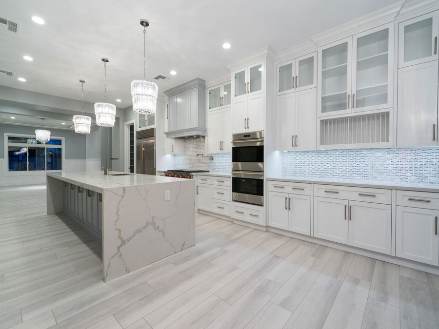 modern style kitchen in white with white quartz countertops